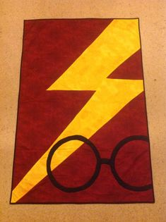 Harry Potter Griffindoor quilt. I made a pattern by copying a picture and top stitched the Lightning bolt and the glasses to the quilt.