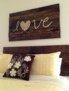 Wood love sign and wood headboard. Heart on sign made out of a shirt DIY rosettes.