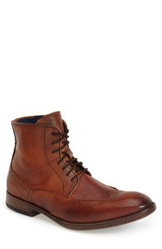 Dune London 'Cobbler' Wingtip Boot (Men)   Fashiondoxy.com  Description - Free shipping and returns on Dune London 'Cobbler' Wingtip Boot (Men) at Fashiondoxy.com. Made in Portugal, a rustic lace-up boot crafted in burnished leather features wingtip panels, a side-zip closure and an authentic, worn-in look.