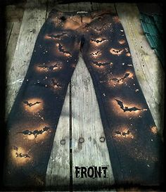 Carve out a bat template with an x-ato knife and mix two parts water and 1 part bleach and spray black pants. Look very halloweenie.