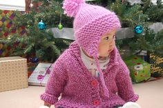 """This hat is called """"Serendipity"""" because it came together exactly as I dreamed of it! Picturing big chunky garter stitch ridges, ending with a bit of twirl-y decreases on a stockinette top, with a big chunky pom pom sitting on the top like a cherry on a sundae, and it came out just so."""