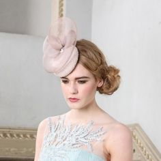 Kate Hat by Jane Taylor Millinery  ~ This beaded mini cocktail hat perches on one side of the head with a little hight from the curled detail. Pearls sit at the centre of the crin. This piece can be made in ivory, nude, navy, black or dyed to order.