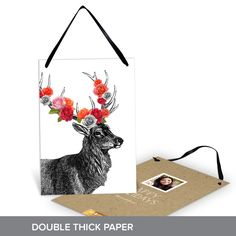 This is a special holiday card that can stay up all year long! This artistic deer is sure to make everyone smile. Friends and family can hang them from doorknobs, mantels or chandeliers—anywhere they want spot of holiday cheer. It's printed on double thick paper so this card feels super fancy when received! #holiday #ChristmasCards #PremiumCards