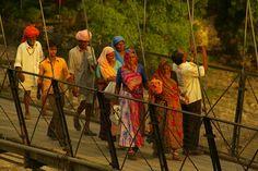 Crossing the bridge, Rishikesh, India