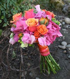 Pink and orange bouquet inspiration {via brownbunnyflowers.blogspot.com} - see more on http://themerrybride.org/2014/04/19/pink-and-orange-wedding/