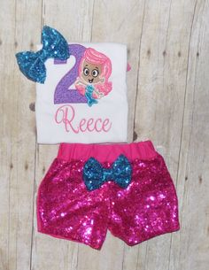 ****** Be sure and Like me on Facebook for special offers and new designs! www.facebook.com/mommamayshop   Bubble Guppies Birthday outfit!!!  Something new!!  Some much versatility of this kind of outfit!! Embroidered bodysuit/shirt, fabulous hot pink 1 side sequin shorts, and bows for her hair, shoulders and waist of the shorts!! Pink, silver, lavender and turquoise sequin shorts are also available!!!! Perfect for bounce house parties, outdoor parties or a comfortable addition the...