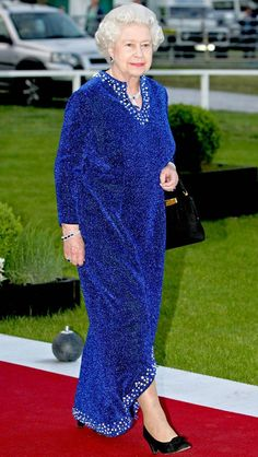 QUEEN ELIZABETH II'S ROYAL STYLE THROUGH THE YEARS 2006 Her Royal Highness attended an Equestrian dinner—part of her 80th birthday celebrations—in a textured blue gown and black velvet heels.