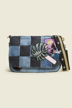 The coolest courier around, this denim patchwork version is a checkerboard combination of various colors and textures all in a classic jean faication. A playful way to update the traditional messenger style bag in a Marc Jacobs approved way.