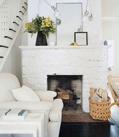 Designer clutter and a perfectly white backdrop make for the perfect mantel. #AmazingMantel