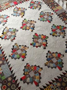 Twirling Fans Quilt. Design by Sharon of Fabrics & flowers, quilting by Jenny of Sew wonderful..