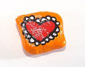 Hand Painted Rock with a Red Heart w/ Orange Background