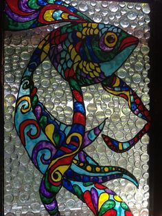 I picked up on the side of the road an old window, spray painted the frame, painted a tropical-like fish using stain glass painted and filling in the negative space with glass stones from the Dollar Tree.