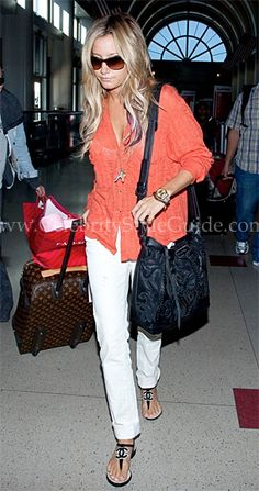 Ashley Tisdale wore a comfortable red fine gauge Free People Stavros Buttondown at LAX Airport on Friday (July 20) in Los Angeles, California.