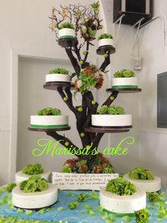 Wedding cake on tree stand. Visit us Facebook.com/marissa'scake or www.elmanjarperuano.com