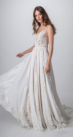 """Rish Bridal 2018 """"Sun Dance"""" Collection – Romantic Timeless Rustic Bohemian Chic Wedding Gown SIERRA - A line silhouette with spaghetti straps. Bodice is over nude lining and made of beaded crochet lace with crystals and pearls, open sides with 2 tassels on each side. Skirt is made of chiffon and lace for the ultimate bohemian elegant look. Comfortable flattering sexy unique laid back bridal gown. #RishBridal #SunDance #SierraByRish #BohoChic #BohoGown #WeddingDress #Romantic #Sponsor"""