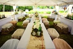 Burlap runners and covered hay bale seating