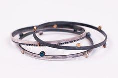 Silver bracelets with gold details and gemstones