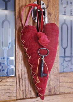 Velvet heart in vintage style, with old key