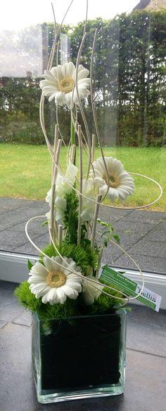 Modern parallel flower arrangement with white gerberas