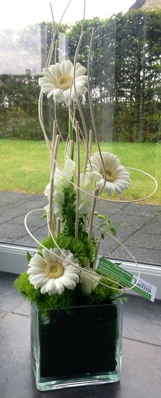 "These ""Fresh Touch"" daisies and bendable sticks can be purchased from couturehomeaz.com"