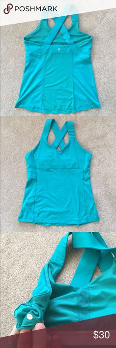 Lululemon Criss-Cross Back Tank Cute strappy athletic tank. Very soft material with a mesh panel on back. Has a supportive shelf bra. Wide straps don't dig in to your skin and sit comfortably. Color isn't depicted accurately in pics! Color is more green/turquoise and is more vibrant. lululemon athletica Tops Tank Tops