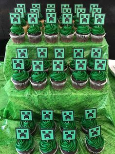 Minecraft themed birthday party creeper cupcake toppers. Click to get all the details for food, party favors, signs, and activities (including free printables) on FabEveryday.com.