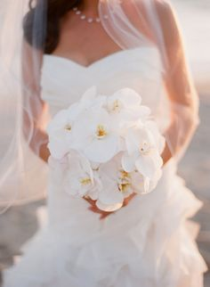 Gorgeous white orchids: http://www.stylemepretty.com/2015/11/22/sofia-vergaras-orchid-wedding-bouquet/