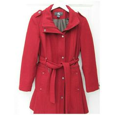 Calvin Klein Dark Red Pea Coat Long Wool Military Worn one season. Excellent condition from Calvin Klein.  Military buttons on shoulders in gunmetal gray. Color is darker red than photos. 57% wool, 25% Polyester, the rest is a blend. Thigh-length, long coat. Super flirty and cute ruffle detail on back. Two functional front pockets, two decorative, matching belt. Size Large/12. Full zipper and snap buttons closure. Please ask any questions before buying! Ships fast with bonus gift ;) Thanks…