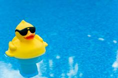 Yellow Rubber duck with shades on blue water, space for copy Beach Fun, Summer Beach, Summer Fun, Baby Hamper, Personalized Baby Blankets, Host A Party, Rubber Duck, Baby Gifts, Cool Stuff
