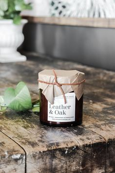 Leather & Oak Candle - Aimee Weaver Designs Barn Wood Signs, Reclaimed Barn Wood, Wooden Signs, Amber Glass Jars, Wood Artwork, Making Signs On Wood, Apartment Makeover, Soy Products, Open Window