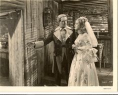 Original, vintage photo of a deleted scene from New Moon with Jeanette MacDonald and Nelson Eddy. Charles and Marianne have just been married. - ESCANO COLLECTION