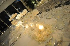 flowers arrangement with rose petals on table