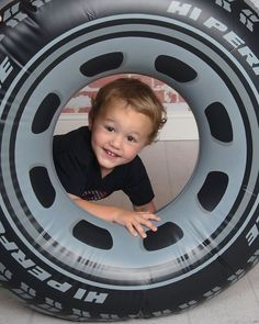 Tire tube pool float used as prop for 3 year old Disney cars Photo shoot.