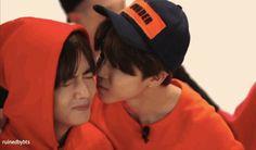 Jimin gives V a kiss on the cheeks
