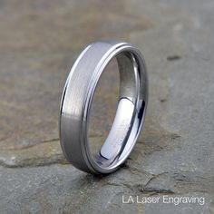 Personalized Engraved Tungsten Polished Edge Ring Brushed Tungsten Carbide Wedding Band polished edges 6mm ------------------------------------------------------------------------------------------- Free Laser Engraving Up to 65 Characters or Symbols ❤ ✝ ∞ Free gift box! Hypoallergenic, Cobalt-Free Scratch resistant Ring Sizes: 5, 5.5, 6, 6.5, 7, 7.5, 8, 8.5, 9, 9.5, 10, 10.5, 11, 11.5, 12, 12.5, 13, 14, 15 Width: 6MM…