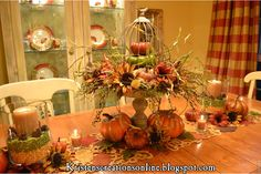 Fall dining room table with cage and pumpkins