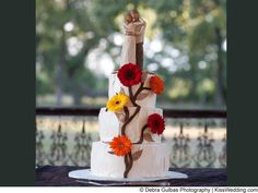 """A fall wedding cake with vines and colorful gerbera daisies from """"Melissa and Brian's Bountiful Wedding Bash"""""""