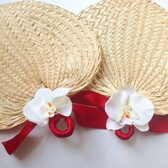 For a laid-back beach ceremony, carry a simple woven palm leaf fan.
