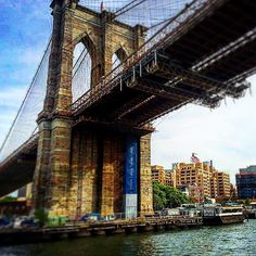 The Watchtower sign standing watch by the Brooklyn Bridge. Photo shared by @craigcarsonea