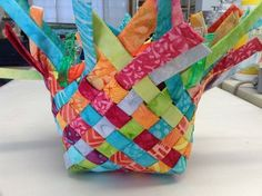 Woven Fabric Basket I had fun last weekend making some little woven baskets out of batik strips. These baskets are often made out of paper such as magazines, newspaper, maps, potato chip bags etc. but I wanted to use fabric. I used. Fabric Strips, Woven Fabric, Scrap Fabric, Fabric Weaving, Sewing Tutorials, Sewing Hacks, Bag Tutorials, Quilting Projects, Sewing Projects