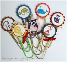 decorate extra large paperclips to use as bookmarks