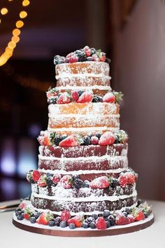 Beautiful naked wedding cake with fresh berries... what a perfect idea for a rustic wedding!  |Photography by Lumaluna Photography|  |Kansas City Wedding Cakes|