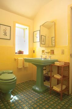 Yellow and green were a fairly common combination, but the floor is a showstopper. The unusual pattern was created by the homeowner, who implemented many fashion trends during her home's construction in (Photo: Andy Olenick) Black Tile Bathrooms, Yellow Bathroom Decor, Art Deco Bathroom, Ideal Bathrooms, Bathroom Paint Colors, Vintage Bathrooms, Beautiful Bathrooms, 1950s Bathroom, Colorful Bathroom