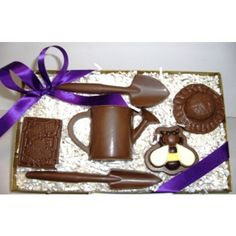 This Chocolate Gardening set comes complete with a seed-pack, shovel, watering can, chocolate honeybee and more!  Available in Delicious Milk, Dark or White Chocolate.