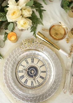 """I've updated my 2012 NYE """"clock-themed"""" tablescape that some of you may remember. All you have to do to recreate this look is have a set of clear glass dinner plates which are really inexpensive and also so versatile! Then print off a set of clock faces so they fit the size of an 8.5 x 11 sheet of paper. No fancy paper needed! The clock faces will be round, so just cut them out carefully with scissors. Nestle them between your glass plate and a silver or gold charger plate."""