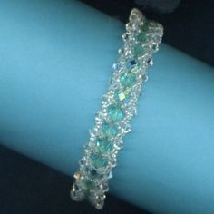 Flat Spiral Bracelet with Swarovski Crystals and Czech Crystal Beads - Aqua AB