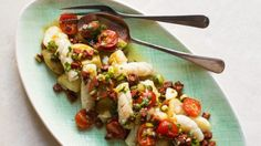 Squid and new potatoes with fried chorizo dressing