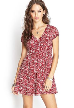 Style Deals - This crepe woven dress features a floral print and puffed short sleeves. Complete w...