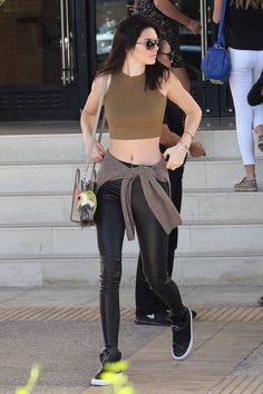 Kendall works the crop top style (but even high waisted jeans won't cover a belly with something this short)