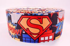 """3"""" Wide Superman Printed on Grosgrain Cheer Bow Ribbon - Thermal printed on white polyester grosgrain ribbon Hard to find 3 inch wide cheer bow size! . Make your own cheer bows and save money $!$ This"""